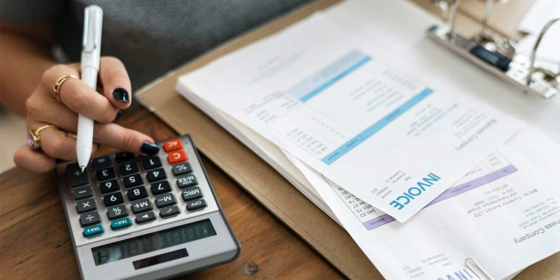 calculating finances calculator and pen