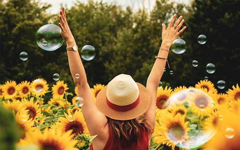 girl sunflower field bubbles