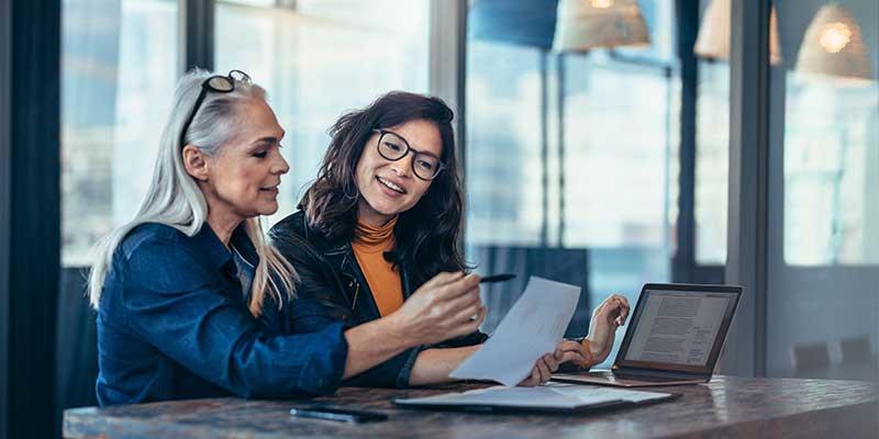 two females laptop talking