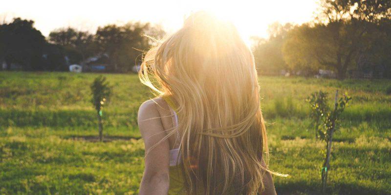 girl sunset grass field