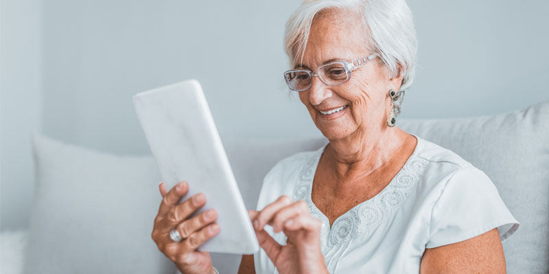 elderly lady using app on tablet